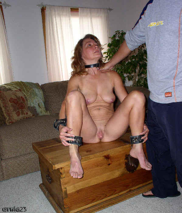 Wife stripped naked and humiliated