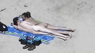 2274couple handjob hidden cam on beach