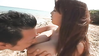 buxom asian at the beach