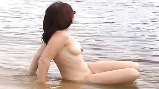 delicious nude female on the beach