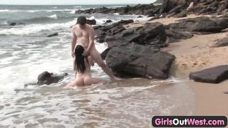beauty plumbing a stranger at the beach