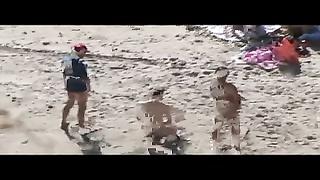 7956Voyeur on public beach. Group hook-up  before spectators