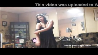 indian wifey  in bedroom dancing for spouse  to taunt  him to manufacture his temper for hook-up