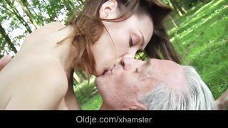 ancient hippie guy smashes a hottie young female in the woods