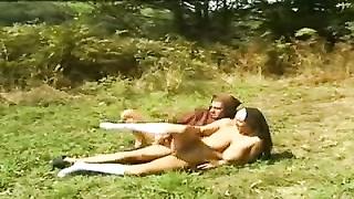 Nun with white socks plumbs outdoors