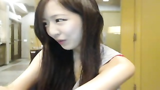 Amateur korean girl strips in an office