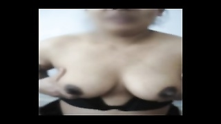 Indian wife shows off large nipples and gets spunked on them