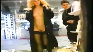 2 girls flash in airport book store