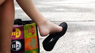candid teenage  Shoeplay Feet gams  suspending Public