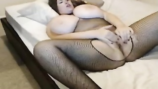 doll  with very large bouncing tits fingers her fuckbox