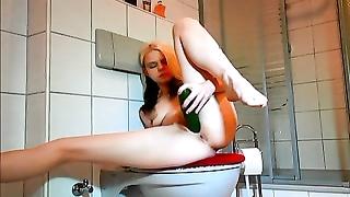 super hot emo honey  jerks with cucumber in bathroom