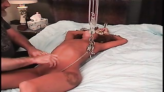 youthful brunette's shaven pussy is tortured on bed by mature sub  master dude