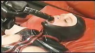Latex fake penis  pants being set aside on restrain bondage  female