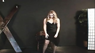little boobies hotty in a black dress  and nylons getting ready for some act