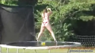 leaping bare on a trampoline