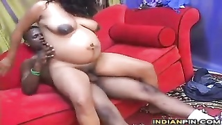 Pregnant Indian With A shaded stud