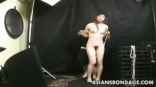 hotfoot oriental gets treated to a bdsm wire session