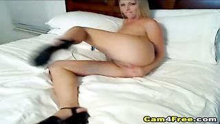 Gorgeous blonde babe gives you another hardcore webcam show where she plays her tight shaved cunt in