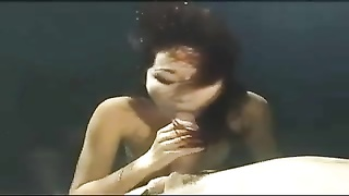 Asian mermaid gives an underwater blowjob