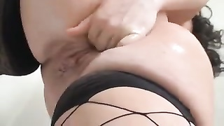 full lady in fishnets and her dildo play