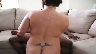 Wife climbs aboard big black cock for ride