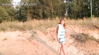 american babe shows pink on the hot sand