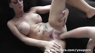 Fisting her pierced and tattooed monster pussy