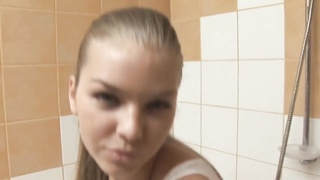 Lovable Euro teen showering and showing cage