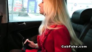 Blond female friend cheating in a pretend taxi