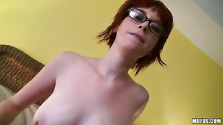 Redhead in sexy glasses is humping wild