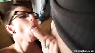 Big-boobed cutie in sexy glasses is being drilled in precisely the gang bang fashion