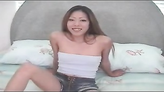 Chinese doll offers a deepthroat blowjob and hand-job to a beautiful young guy