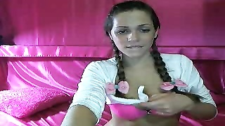 Pigtailed sweetheart is revealing her excited wide-opened mobile phone