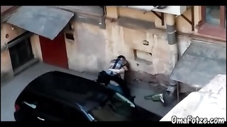 300897OMAFOTZE Young man is fucking granny on parking lot