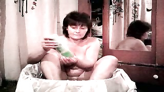 302374Chunky redhead mature milf is shoving a fake cock in her pussy