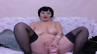 Big-breasted black-haired mature is blowing a mouth-watering prophylactic dicks in exactly the creat