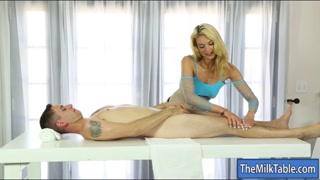 Bushy masseuse pleasuring clients cock
