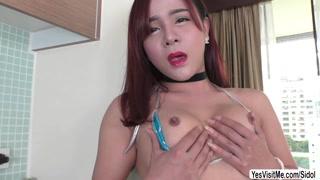 Ladyboy Plam appreciates masturbation