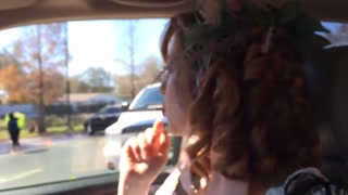 redhead smoking in automobile