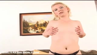 Blond home-made fills her g-spot with a hefty fascinating fake penis
