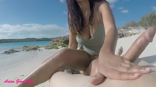Naked beach hand job from Chinese Stunning Gal